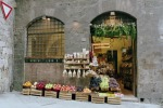The fruitseller. San Gimignano, Tuscany. Photograph. 2005
